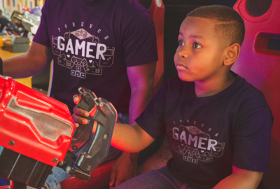 t-shirt-mockup-featuring-a-boy-playing-with-his-father-at-the-arcade-a20545